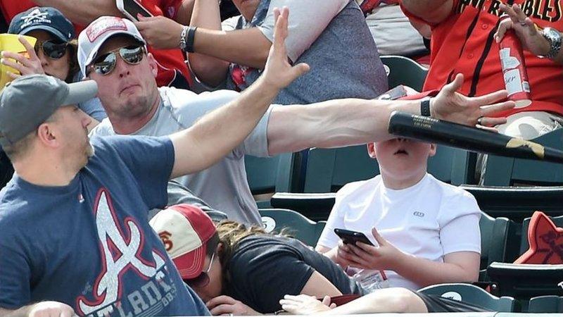 fan saves little boys face from flying baseball bat