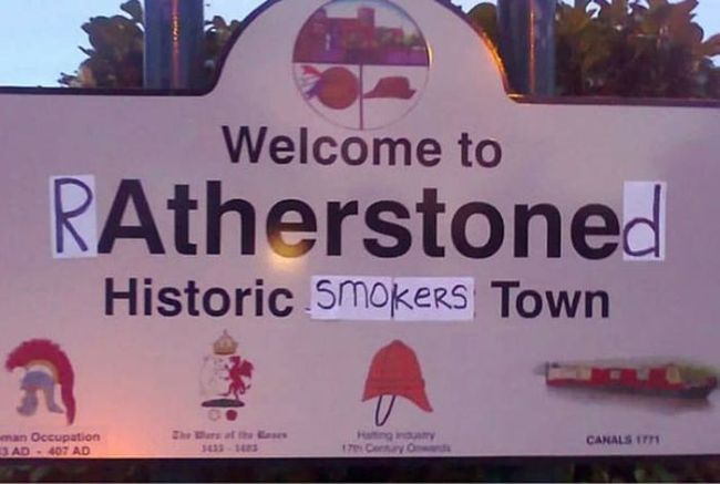 welcome to ratherstoned, historic smokers town, town entrance sign hacked irl