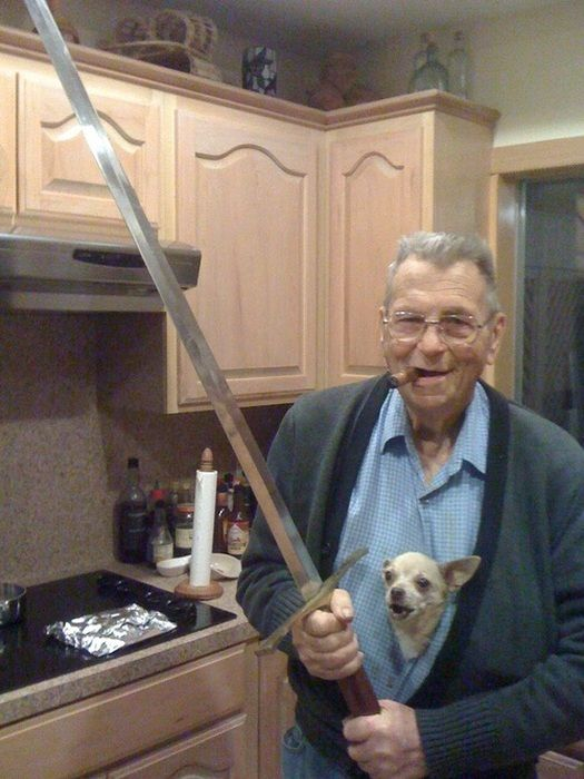 old guy with cigar holding a sword with angry chihuahua in shirt, wtf