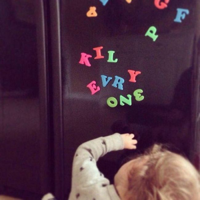kil evry one, kid playing with fridge magnets