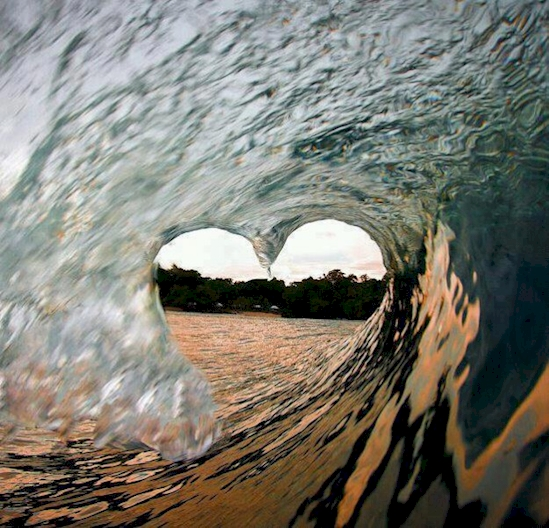 when surfing is your one true love, heart shape in a wave