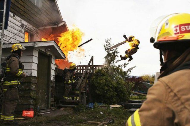 back draft explosion sends fireman flying