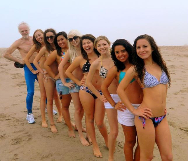 old guy in row of swim wear girls, one of these things is not like the others