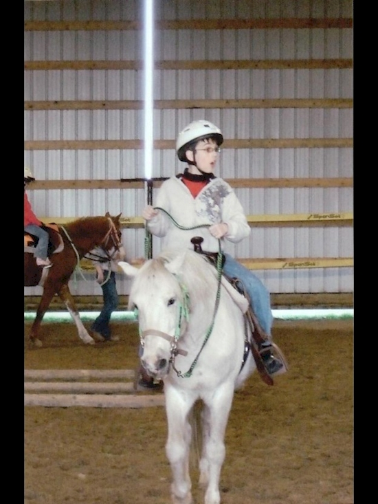 kid on horse with lightsaber