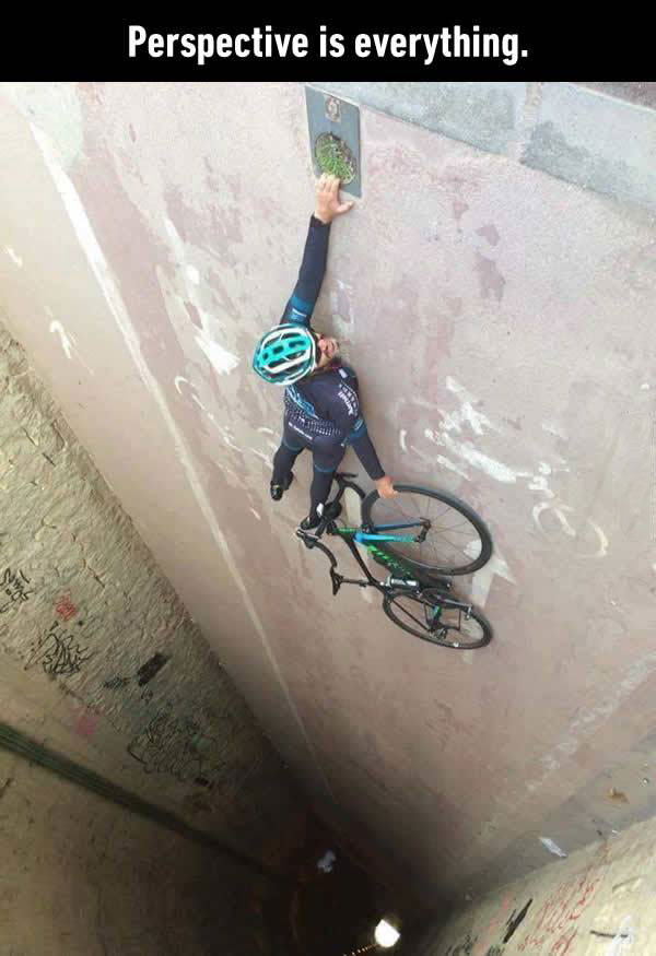 perspective is everything, biker hanging above a tunnel