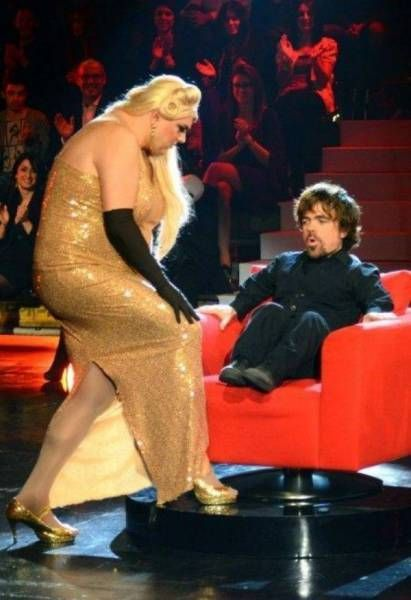 peter dinklage is worried by a large woman