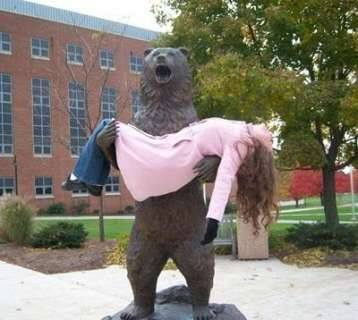 bear statue holding passed out woman, when statues attack