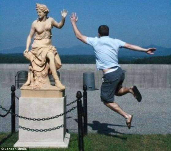 high fiving the statue, hacked irl