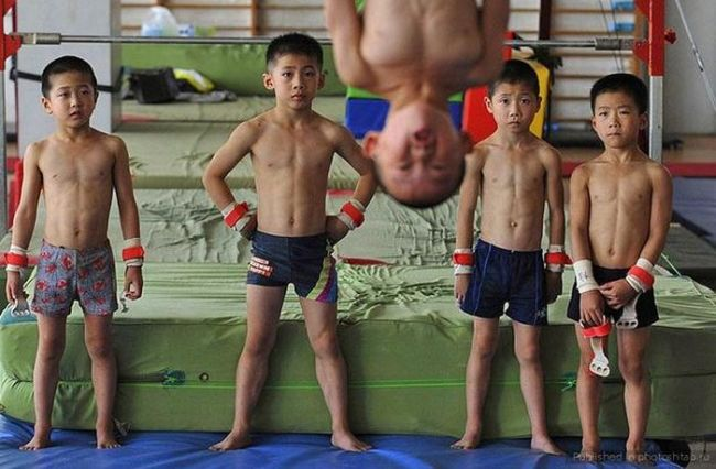 mixed martial arts group photo upside down photobomb