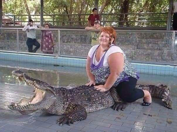 oh my god that poor creature, fat lady riding crocodile