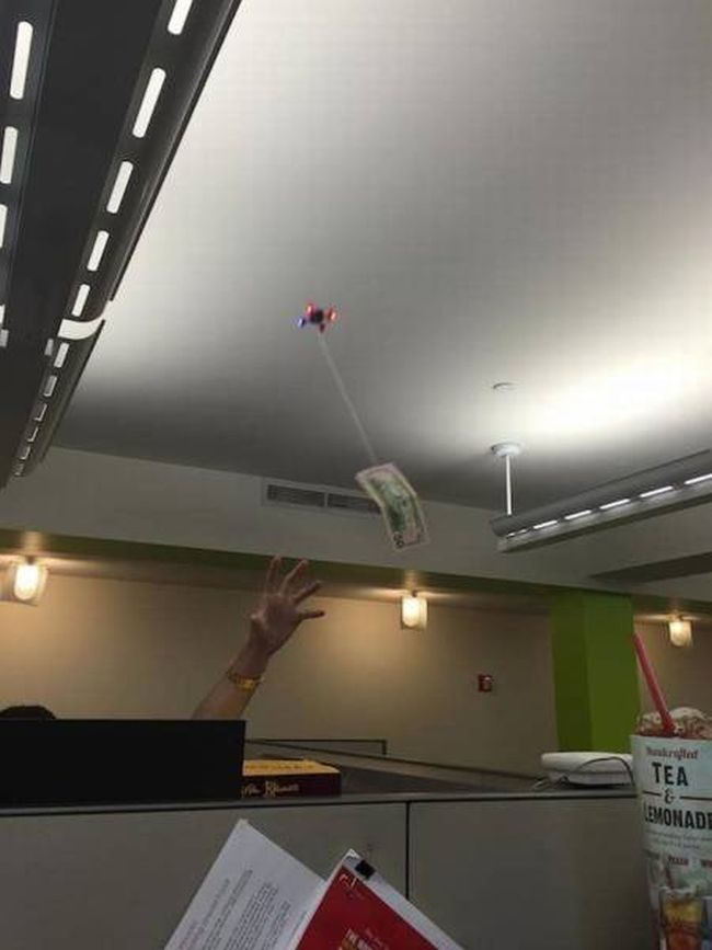 trolling your poor coworkers with a drone carrying money on a string