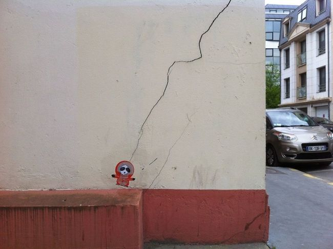 kenny hit by lightning street art, crack in wall reimagined