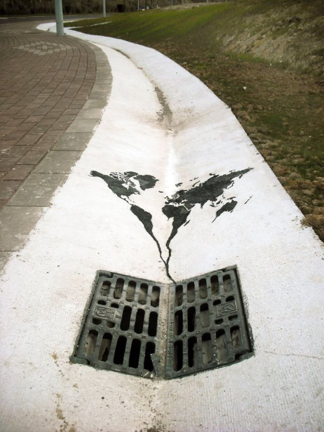 the world is going down the drain in this street art