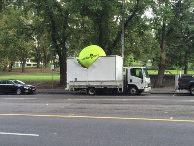 tennis advertisement done right, tennis ball impacted into truck, clever ads