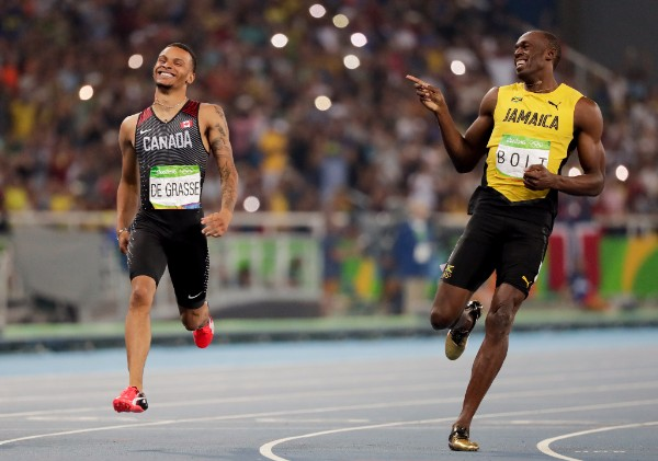 as a canadian who loves jamaica, this is awesome, andre de grasse and usain bolt at the 200m semi final finish line