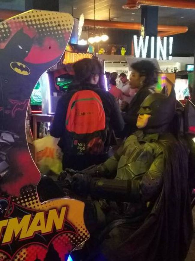 batman playing batman arcade game, costume