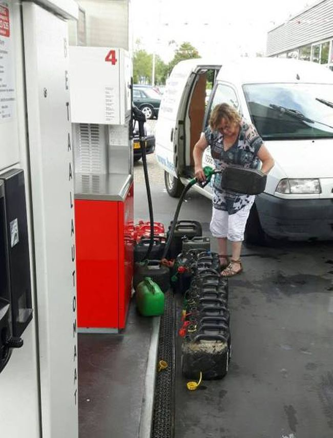 when you need all the gas, lady filling 18 containers of gasoline