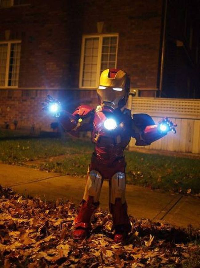little kid dressed as iron man for halloween, win