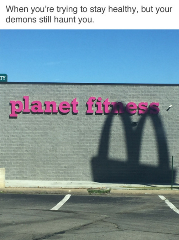 when you're trying to stay healthy but your demons still haunt you, mcdonalds shadow over planet fitness store sign
