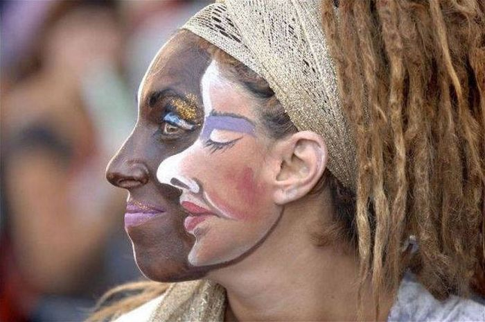 white face on black face on white woman