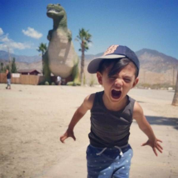 kid reacting to giant dinosaur