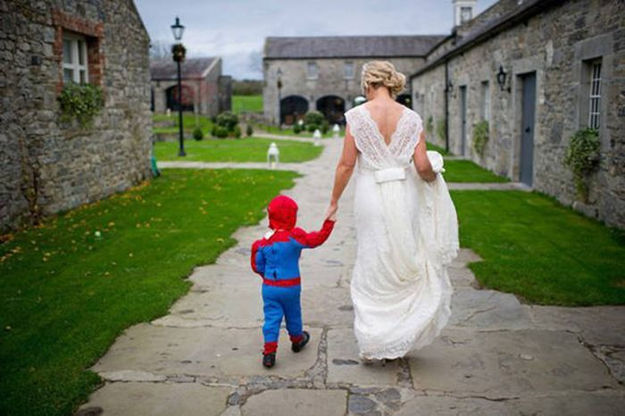 spiderman visits a wedding, kid in spiderman costume, bride