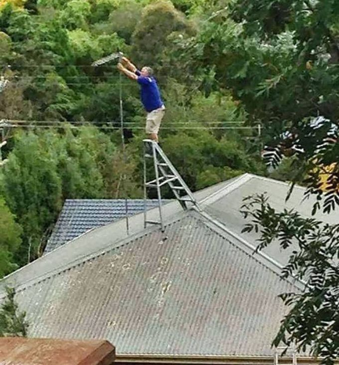 worst antenna repair man ever, ladder on roof, unsafe work conditions