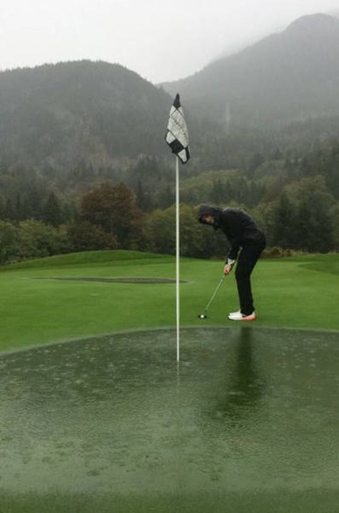 when the hole is also the water hazard, rain on a golf course