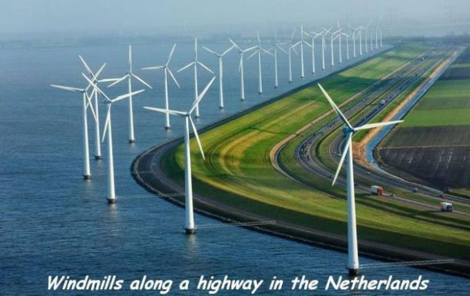 windmills along a highway in the netherlands