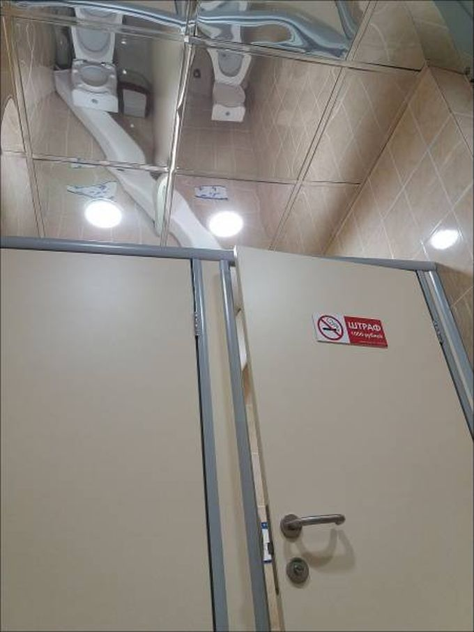 mirror on ceiling of public bathroom, design fail
