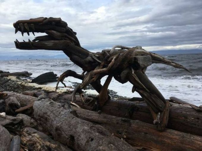dinosaur made from driftwood on the beach, art, win