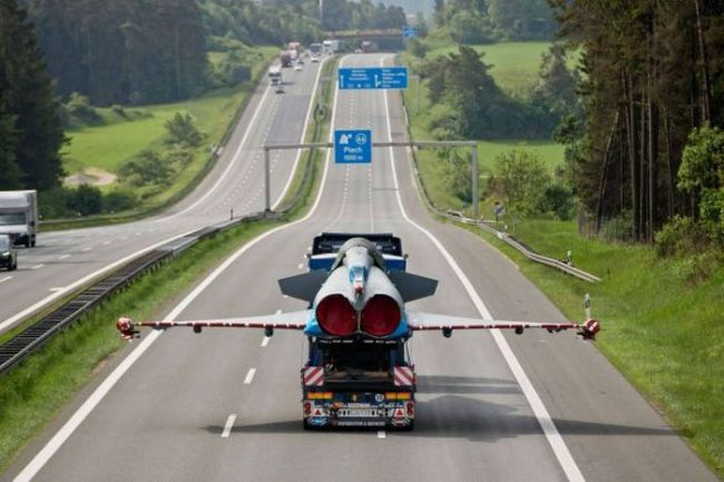 when you're stuck behind a slow driver but don't dare pass, fighter jet on truck on the highway