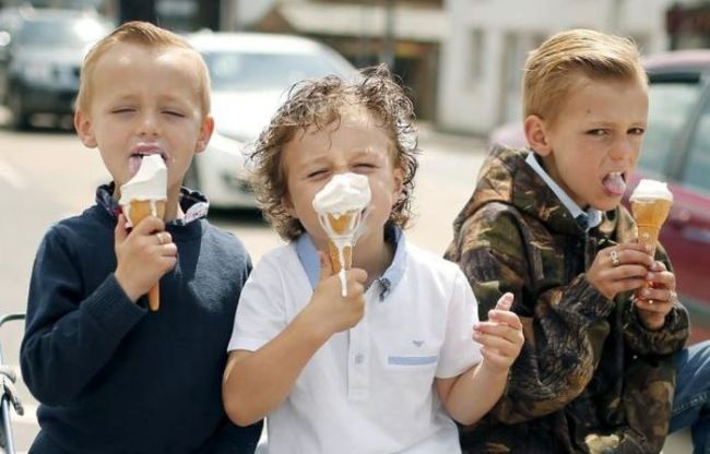three bad boys and their ice dripping cream cones