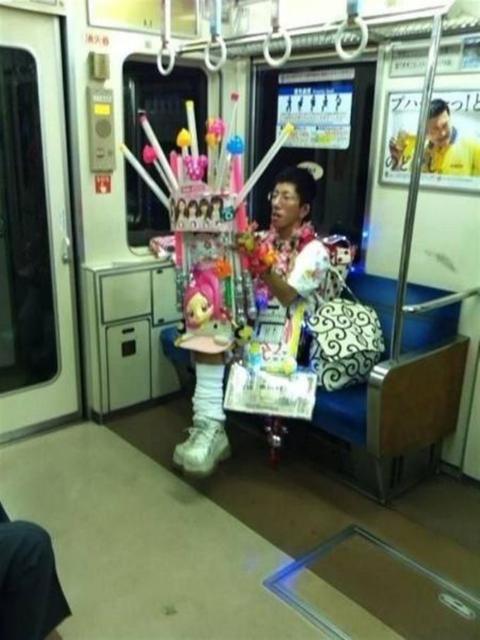 asian man with epic toys on the subway