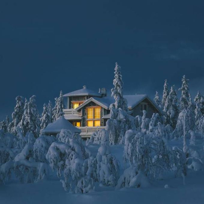 big snowy chalet at night, cottage in a winter wonderland, merry christmas from justpost