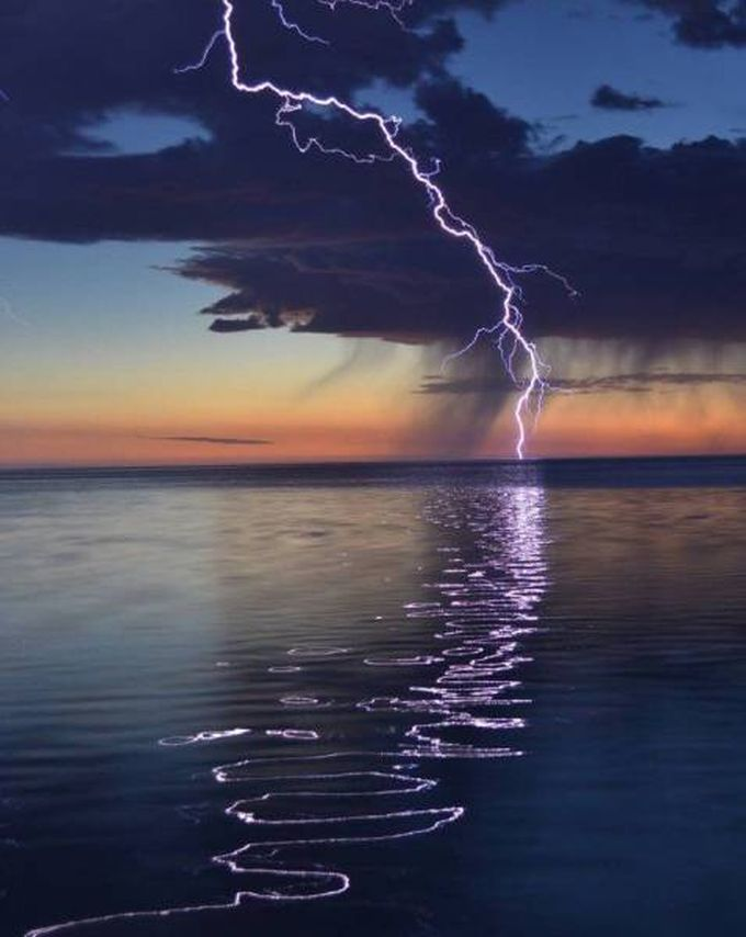 reflection of lightning over water