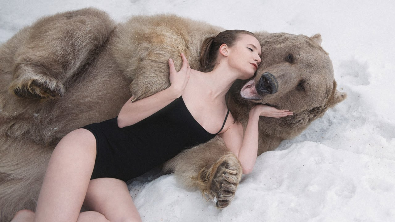 russian model poses with bear