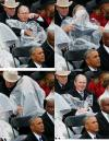 geode w bush having trouble with his rain gear at the inauguration