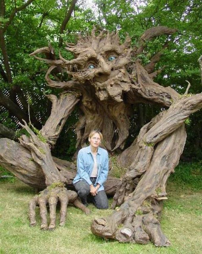 big wooden tree sculpture and the artist that created him