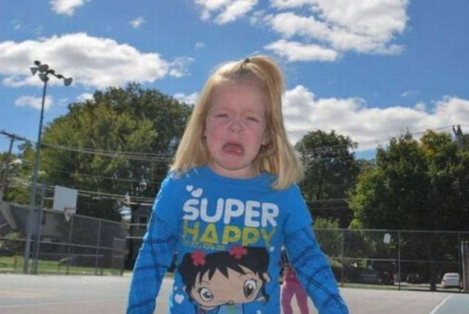 super unhappy girl wearing super happy shirt