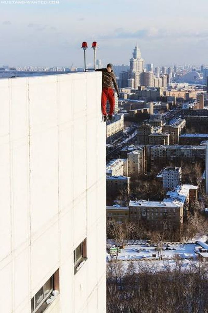 guy hanging off the side of a building