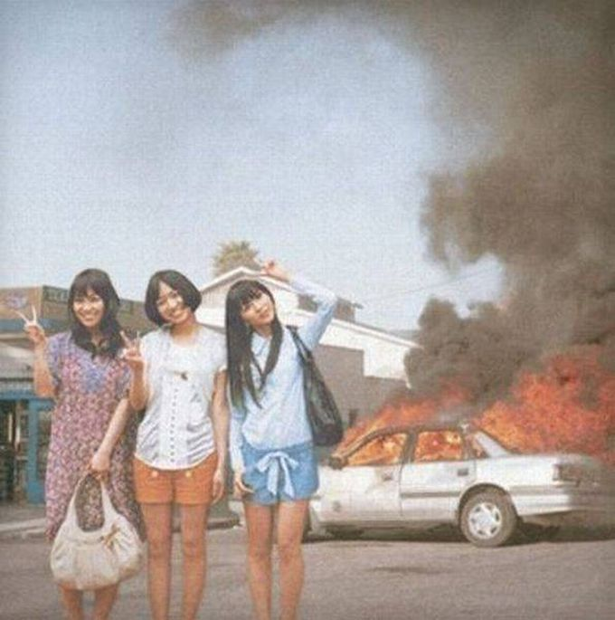 chinese people will pose for photographs in front of anything, car on fire