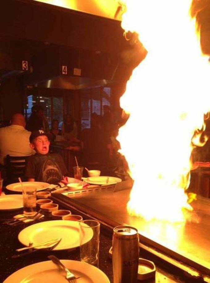 kids reaction to giant flame on table grill surface at restaurant, lol