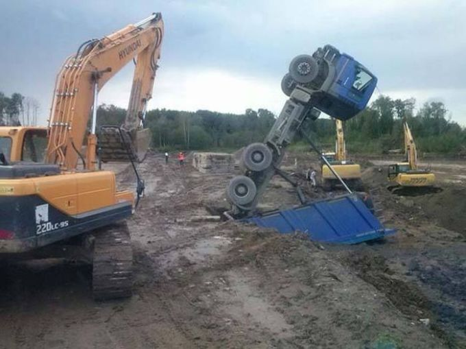 trouble at the construction site, overturned dump truck