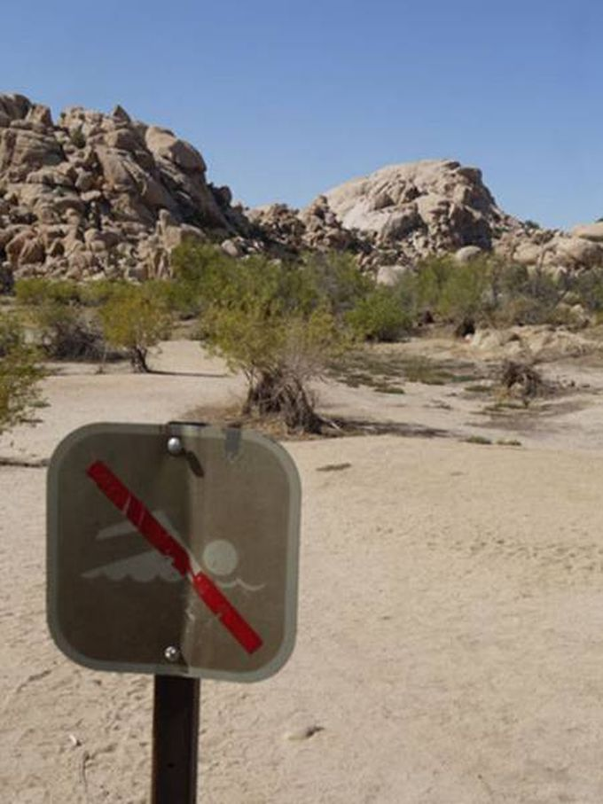 no swimming sign in the desert