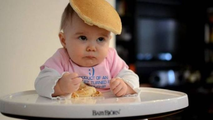 baby with pancake on head