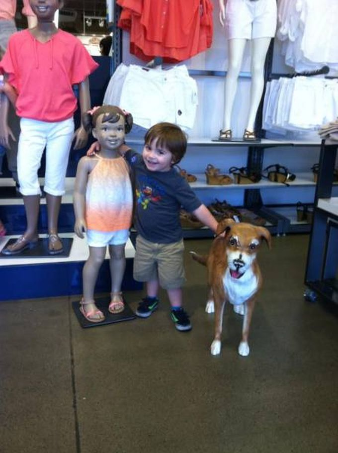 kid finds his dream life at old navy, kid with mannequin girl and dog
