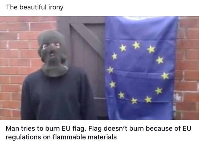 the beautiful irony, man tries to burn eu flag , flag doesn't burn because of eu regulations on flammable materials