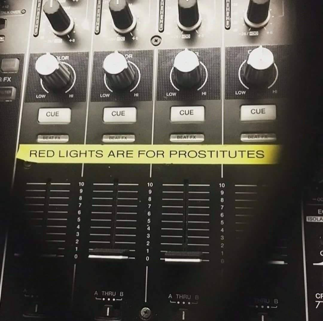 red lights are for prostitutes, label on dj booth mixer