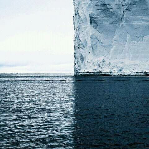 a photo with four perfect quadrants, ice berg, ocean